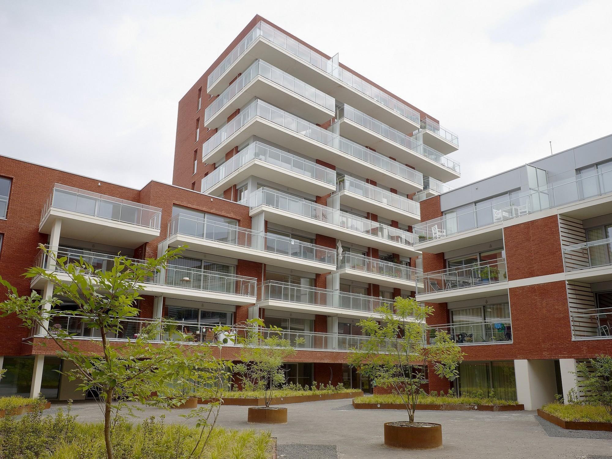 Afbeelding: Architectuur fotografie, modern appartement te Leuven, gebruik van architectonisch beton, productfotograaf Foto Van Huffel.
