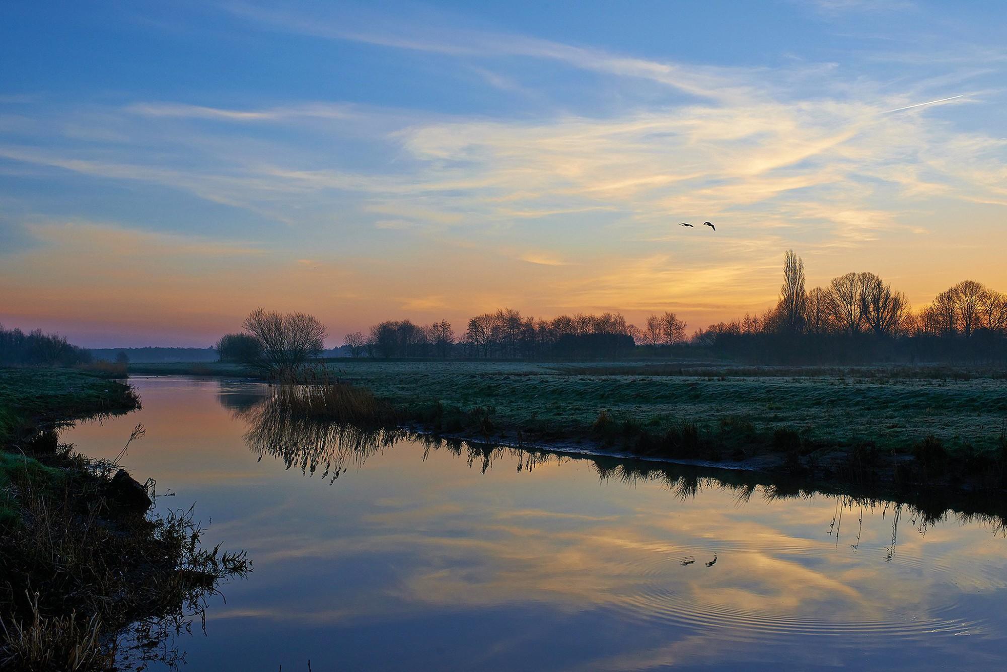 Afbeelding: Landschapsfotografie De Mark op de grens met Nederland, fotograaf Dominique Van Huffel.