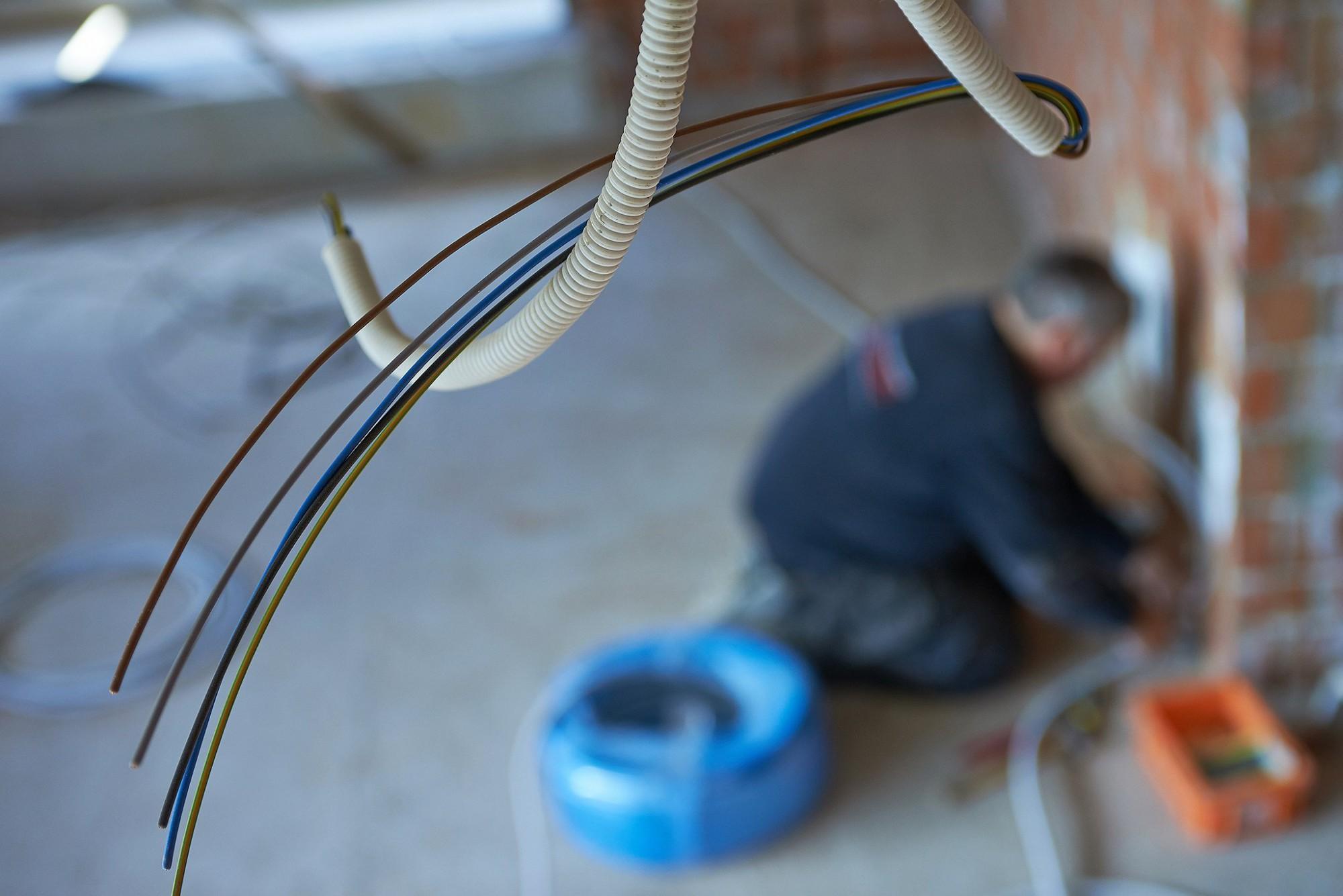 Afbeelding: Werf fotografie aanleg elektriciteit in appartementen voor Elotec.